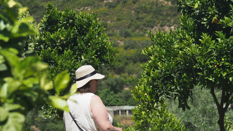 A Beautiful Day at the Botanical Garden In Crete Popular In The Park Woman In White Woman In Nature Woman In A Hat Woman In Park Women Around The World