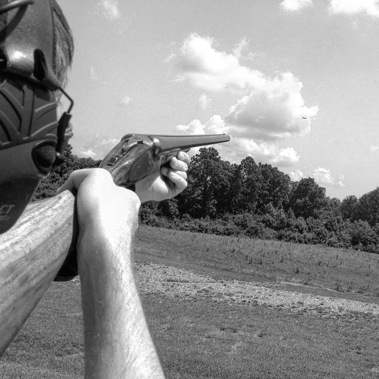 Clay Pigeon Close-up Day Ear Holding Human Body Part Human Hand Men Nature One Person Outdoors People Protection Real People Rifles Shotgun Sitting Sky Sporting Sportsman Tree