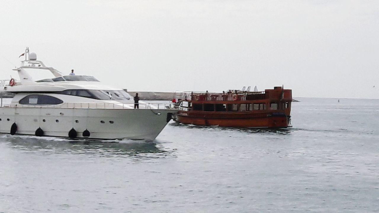 Traditional boat vs modern yacht. DMYC DUBAI