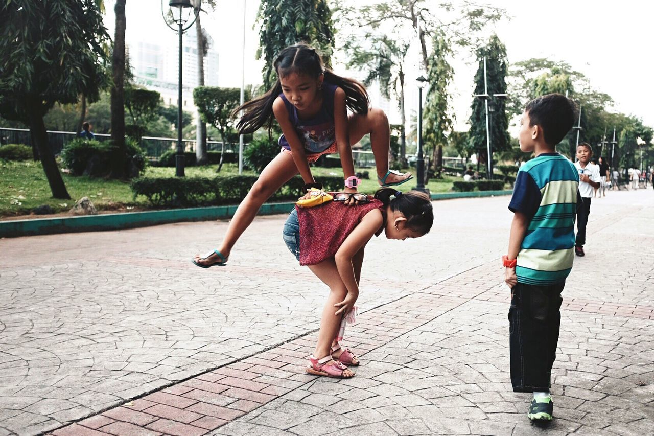 Spotted at Rizal Park in Metro Manila , a group of children enjoys their weekend time being themselves. Eyeem Philippines EyeEm Best Shots X100t FujiX100T Fujifilm Streetphotography Adrenaline Junkie Showcase: December My Best Photo 2015 Recommended Photographers January Youth Of Today The Street Photographer - 2016 EyeEm Awards
