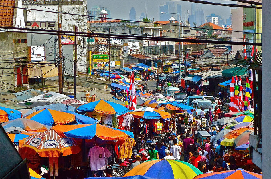 The atmosphere of a traditional market in Jakarta in a busy area welcome the atmosphere of Eid Adults Only Architecture Bike Building Exterior Built Structure Celebration City Croweded Cycling Cycling Of Nature Cyclingphoto CyclingUnites Jakarta Indonesia Large Group Of People Markettraditional Multi Colored Outdoors Pasar People Postcard Sky Tradition Travel Travel Destinations Umbrella