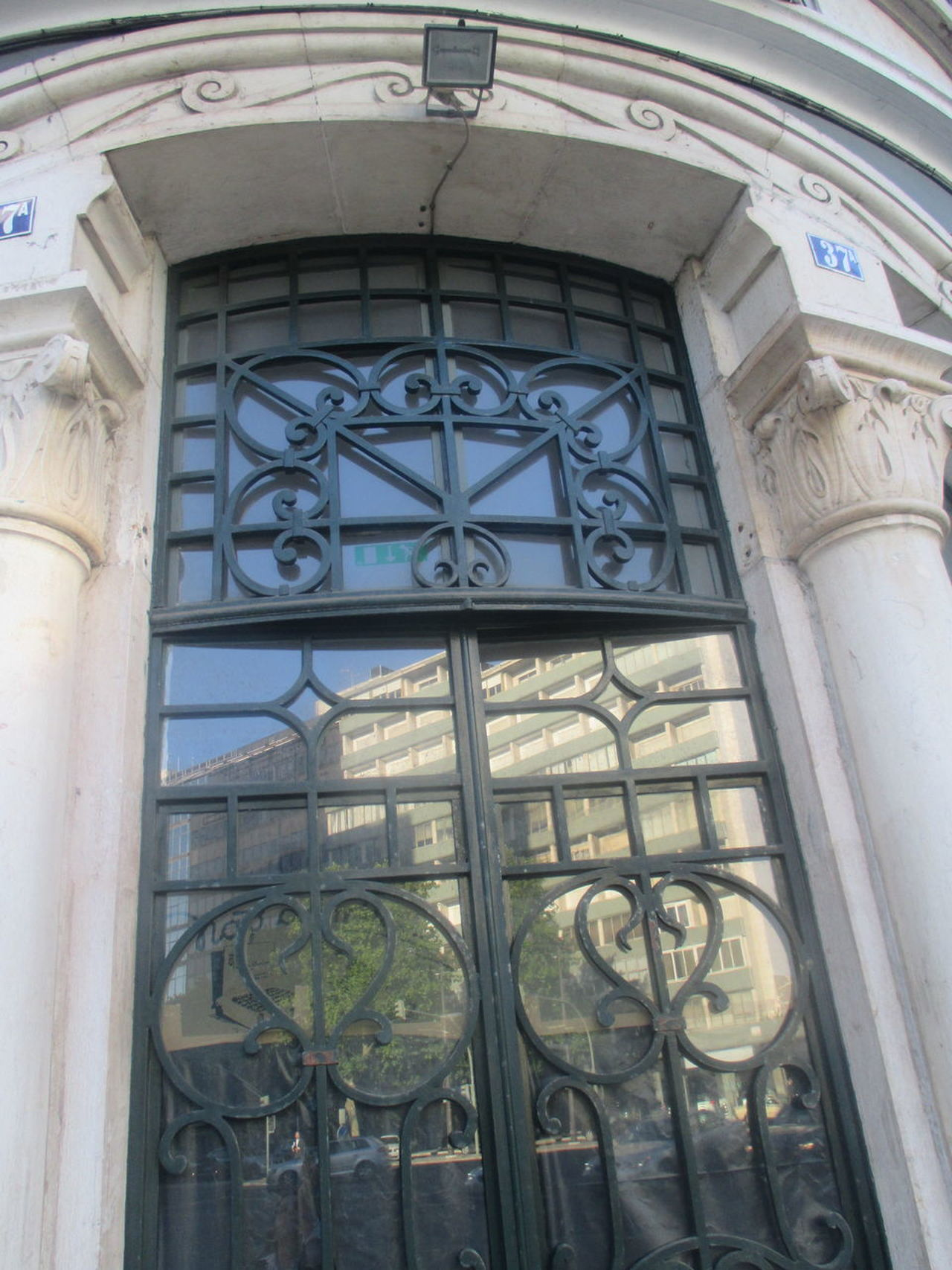 #beautiful Entrance Door #beautiful Old Door #blue Sky #entrance #entrance Door #glassart #iron And Glass #iron Gate #iron Ornaments #iron Ornaments On The Gate #old Style #reflection #reflection Of The City Architecture Building Exterior Building Gate Built Structure Close-up Day Low Angle View No People Old Gate Outdoors Urban Details Window