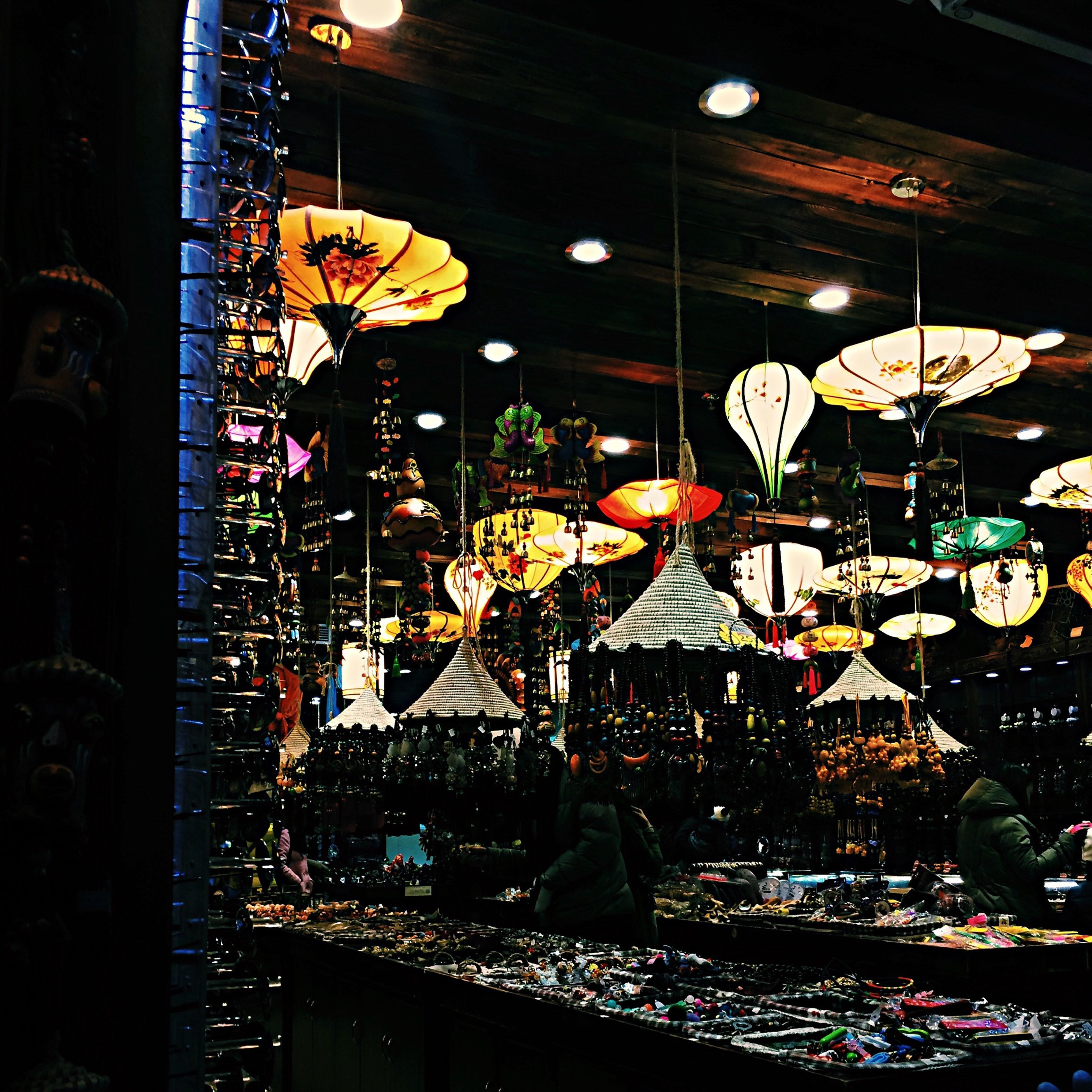 illuminated, night, lighting equipment, decoration, celebration, arts culture and entertainment, multi colored, built structure, hanging, low angle view, architecture, indoors, amusement park, light - natural phenomenon, tradition, building exterior, lantern, christmas decoration, christmas, amusement park ride