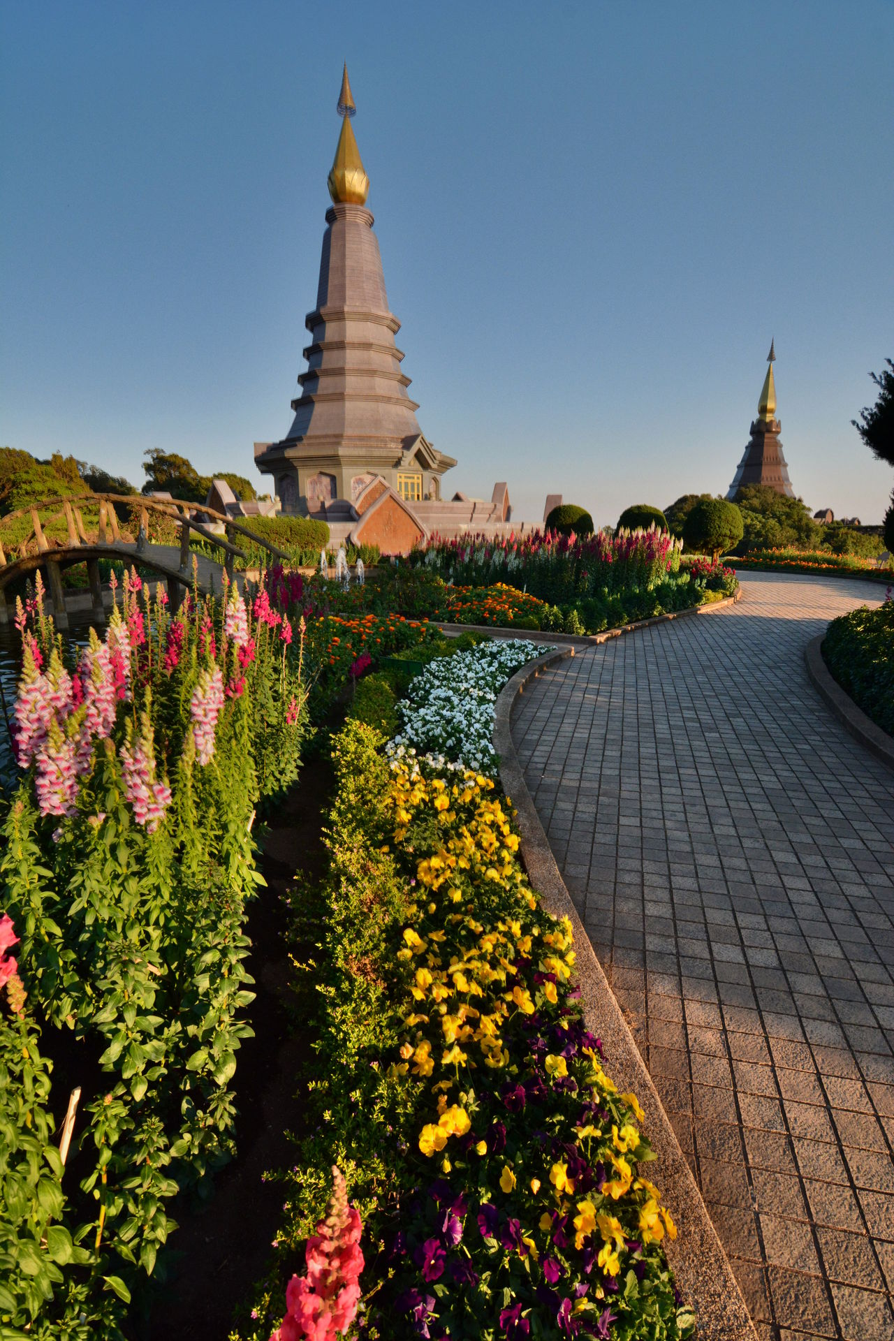 Two chedis near the summit of Doi Inthanon. Chiang Mai province. Thailand Architecture Buddhism Building Exterior Built Structure Chedi Chiang Mai Chiang Mai Province Doi Inthanon Doi Inthanon National Park EyeEm Thailand Flower Highest Mountain Mountain Naphamethinidon Naphaphonphumisiri Nature No People Outdoors Spirituality Thai Thai Mountain Thailand Tourism