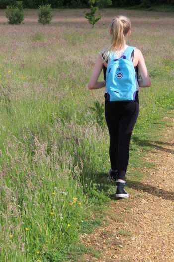 Blue Casual Clothing Child. Childhood Countryside. Female Field Girl Walking On Path. Grass Grass. Landscape Leisure Activity One Person. One Personality. One Heart Rucksack.