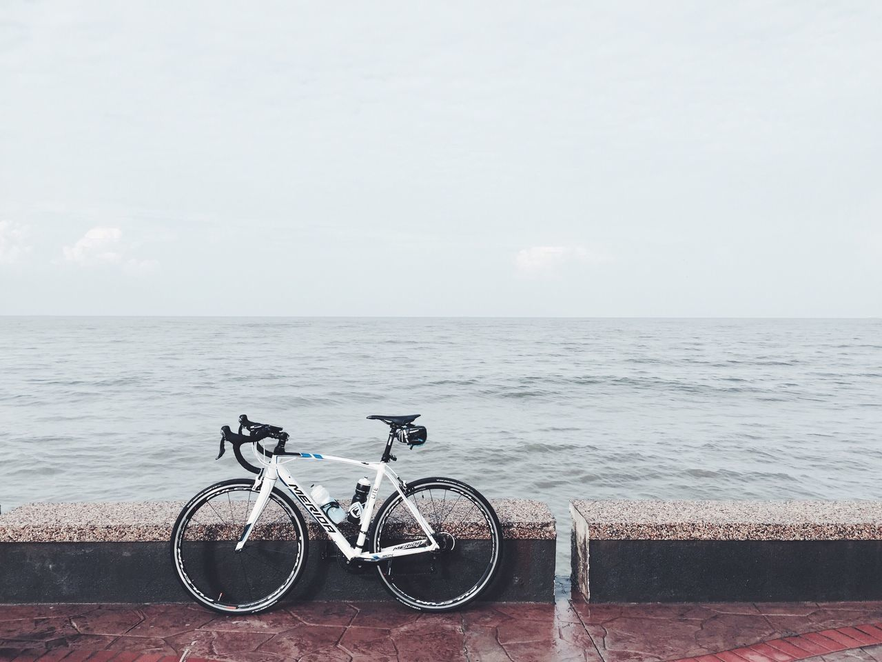 sea, horizon over water, water, sky, no people, bicycle, nature, outdoors, scenics, day, beach, beauty in nature