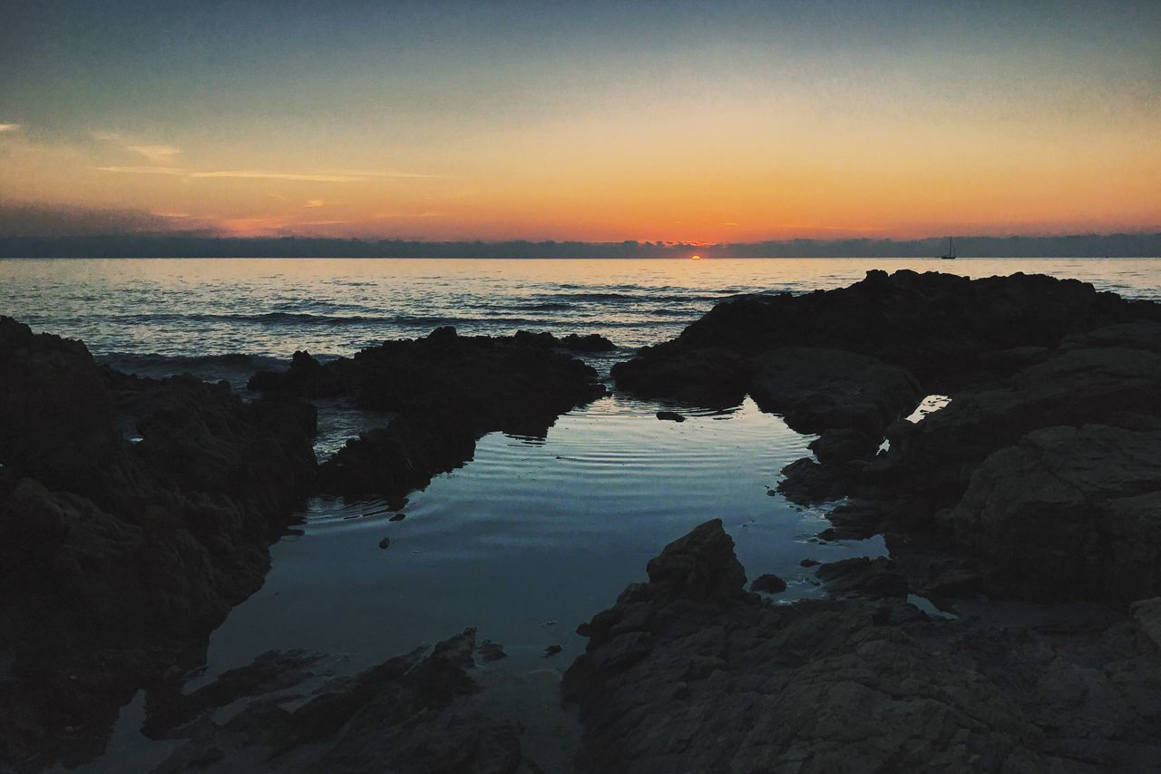 Sunset Water Sea Tranquil Scene Scenics Tranquility Nature Beauty In Nature Sky Rock - Object Beach Silhouette Outdoors Idyllic Horizon Over Water No People Reflection Travel Destinations Landscape Day