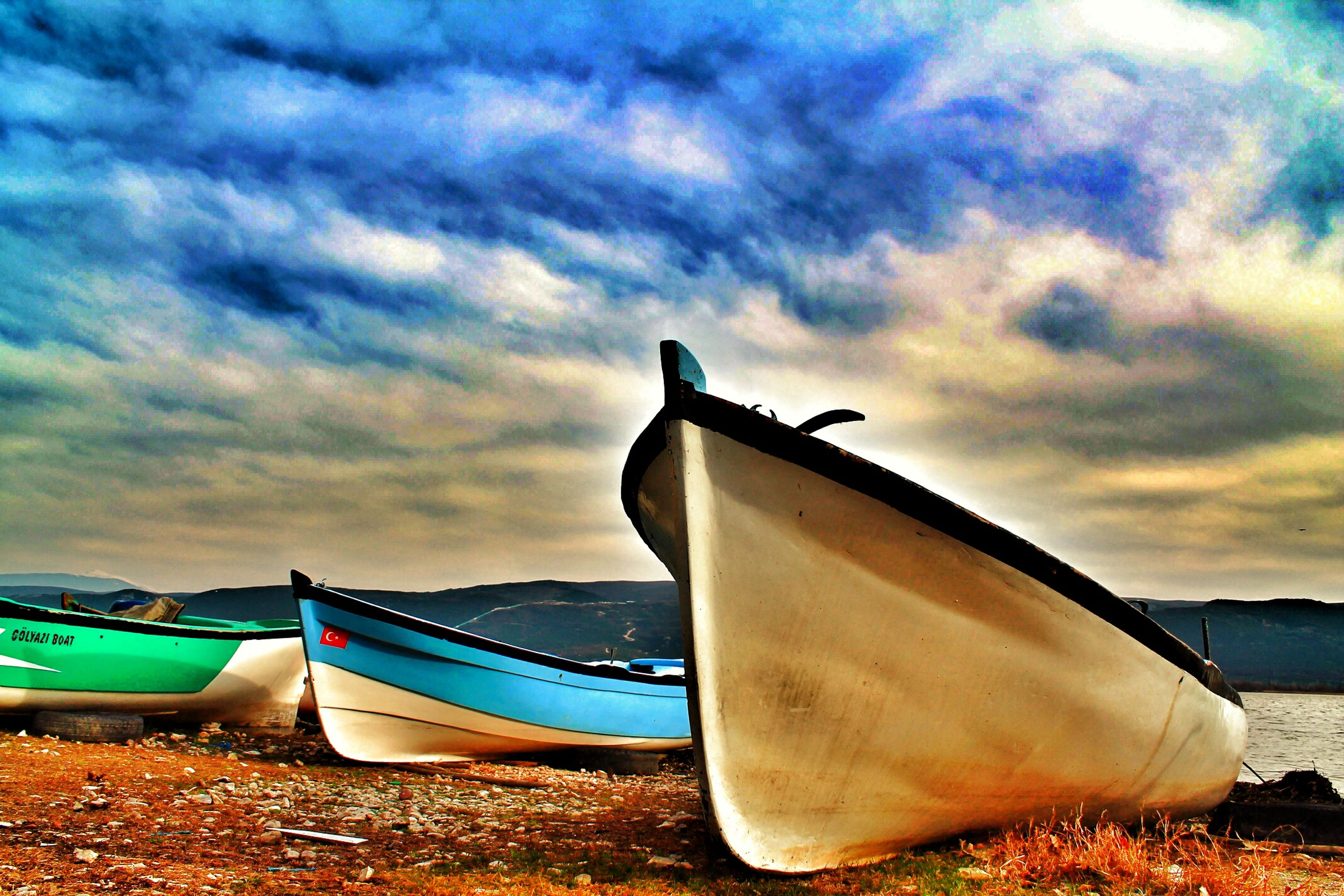 transportation, nautical vessel, mode of transport, sky, boat, moored, cloud - sky, water, cloudy, cloud, sea, beach, sand, shore, tranquility, nature, tranquil scene, travel, beauty in nature, scenics