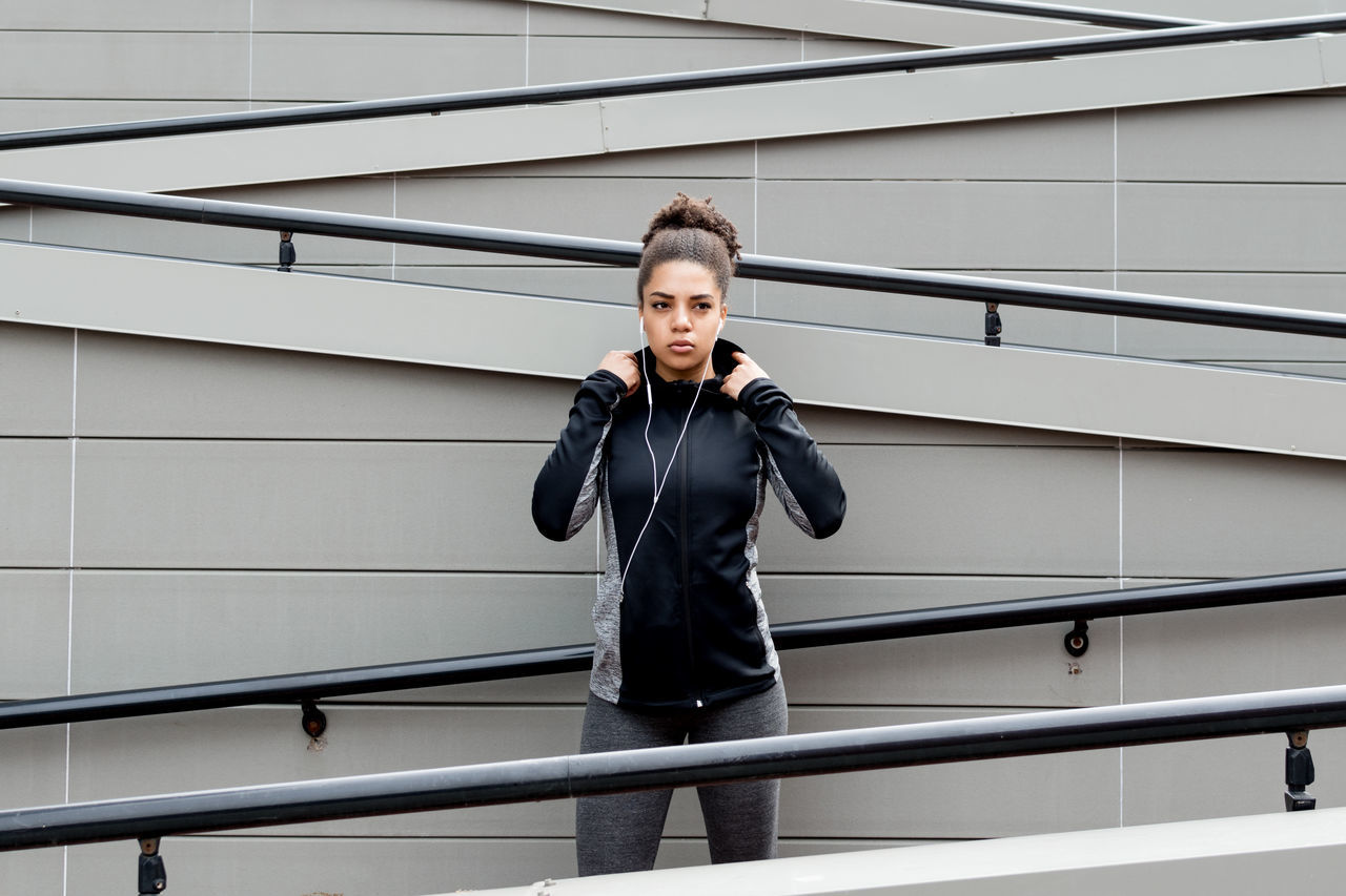 Adult Architecture Athlete Day Fit Fitness Front View Girl Healthy Lifestyle Lifestyles One Person Outdoors People Portrait Railing Real People Sport Sport Clothes Stairs Woman Young Young Adult