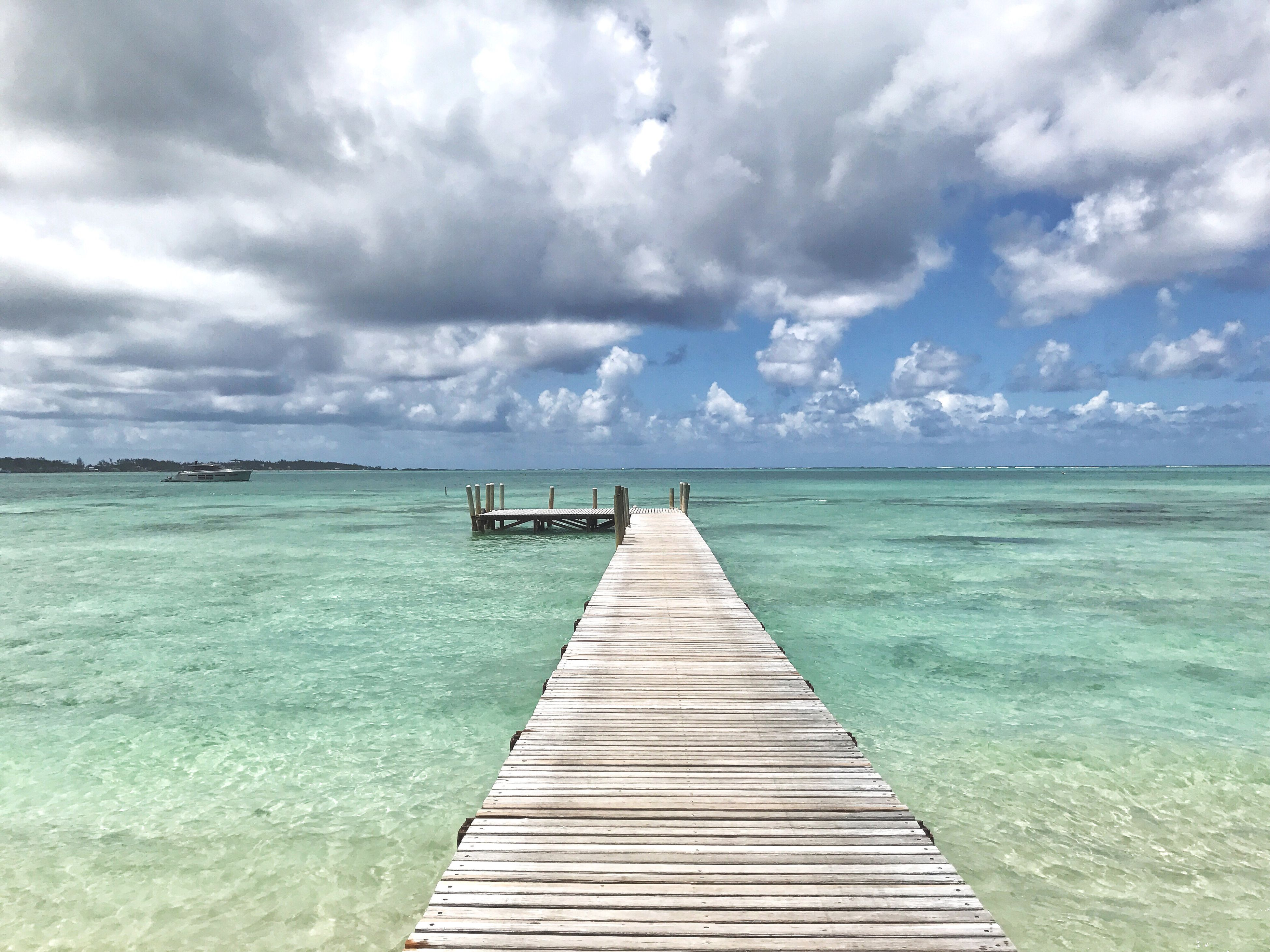 sea, water, horizon over water, pier, nature, beach, cloud - sky, sky, wood - material, boardwalk, no people, outdoors, tranquility, beauty in nature, scenics, day