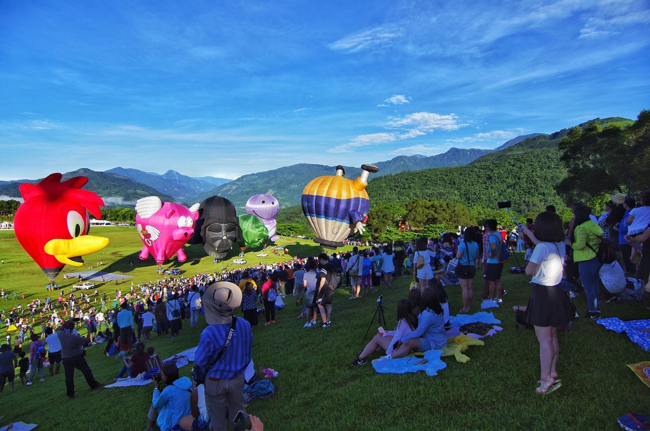 large group of people, real people, men, women, lifestyles, sky, mixed age range, togetherness, celebration, leisure activity, outdoors, crowd, day, blue, nature, mountain, tree, adult, people