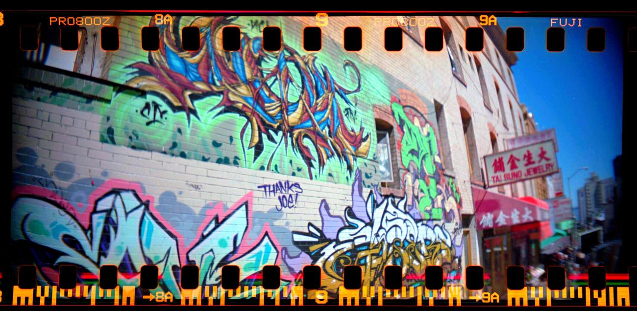 Sprocket Rocket Panorama Multi Colored Text Low Angle View No People Outdoors Day Architecture Koduckgirl Lomo800 Sprocket Holes Film Graffiti
