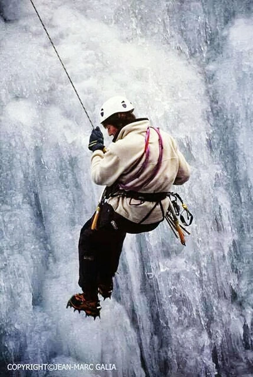 one man only, rope, mid adult, adult, only men, full length, men, ice, adults only, sports helmet, one person, headwear, adventure, people, cold temperature, outdoors, winter, extreme sports, sport, day, human body part, axe, nature, young adult
