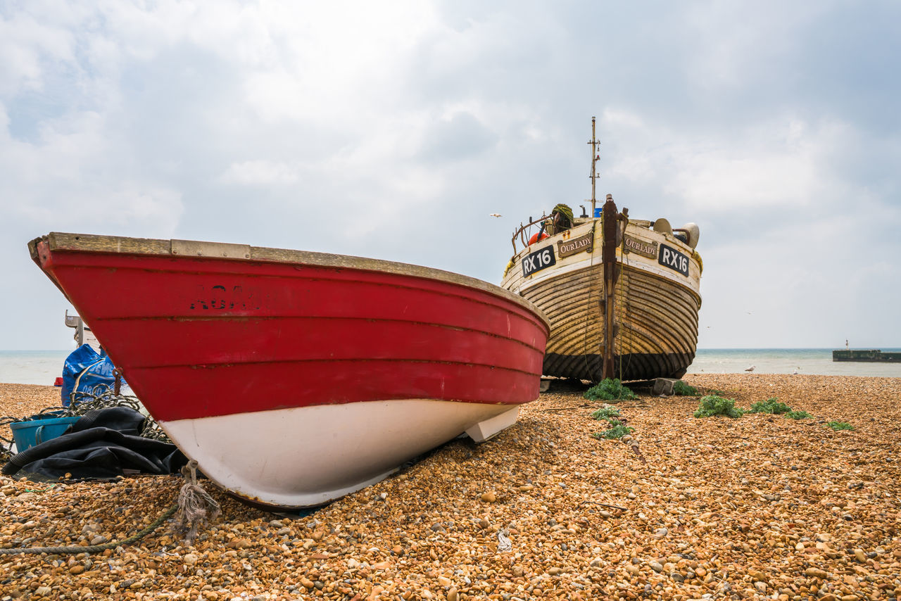 Fishing boats on the beach in Hastings Beach Beauty In Nature Boat Cloud - Sky Day First Eyeem Photo Fisherman Boat Fishing Boats Harbour Industry Mode Of Transport Moored Nature Nautical Vessel No People Outdoors Pebble Beach Sand Sea Sky Transportation