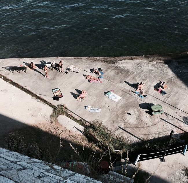 High Angle View Concrete Beach Sunbathing People And Places Harbour