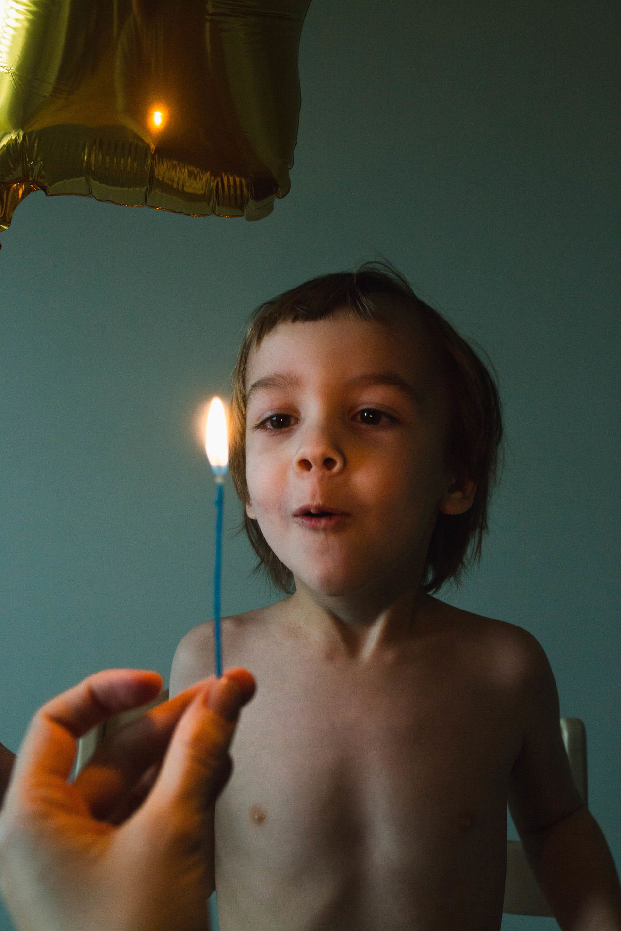 Birthday Cake Birthday Candles Burning Candle Child Childhood Close-up Day Flame Headshot Illuminated Indoors  Lifestyles Looking At Camera One Person People Portrait Real People Shirtless