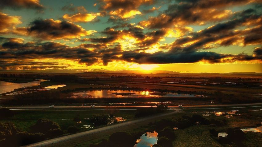 Sunset Sky Cloud - Sky Scenics Beauty In Nature Nature Tranquility Outdoors Tranquil Scene Water Road Landscape Transportation No People Tree Day Dronephotography Drone  Travel Destinations Sunlight