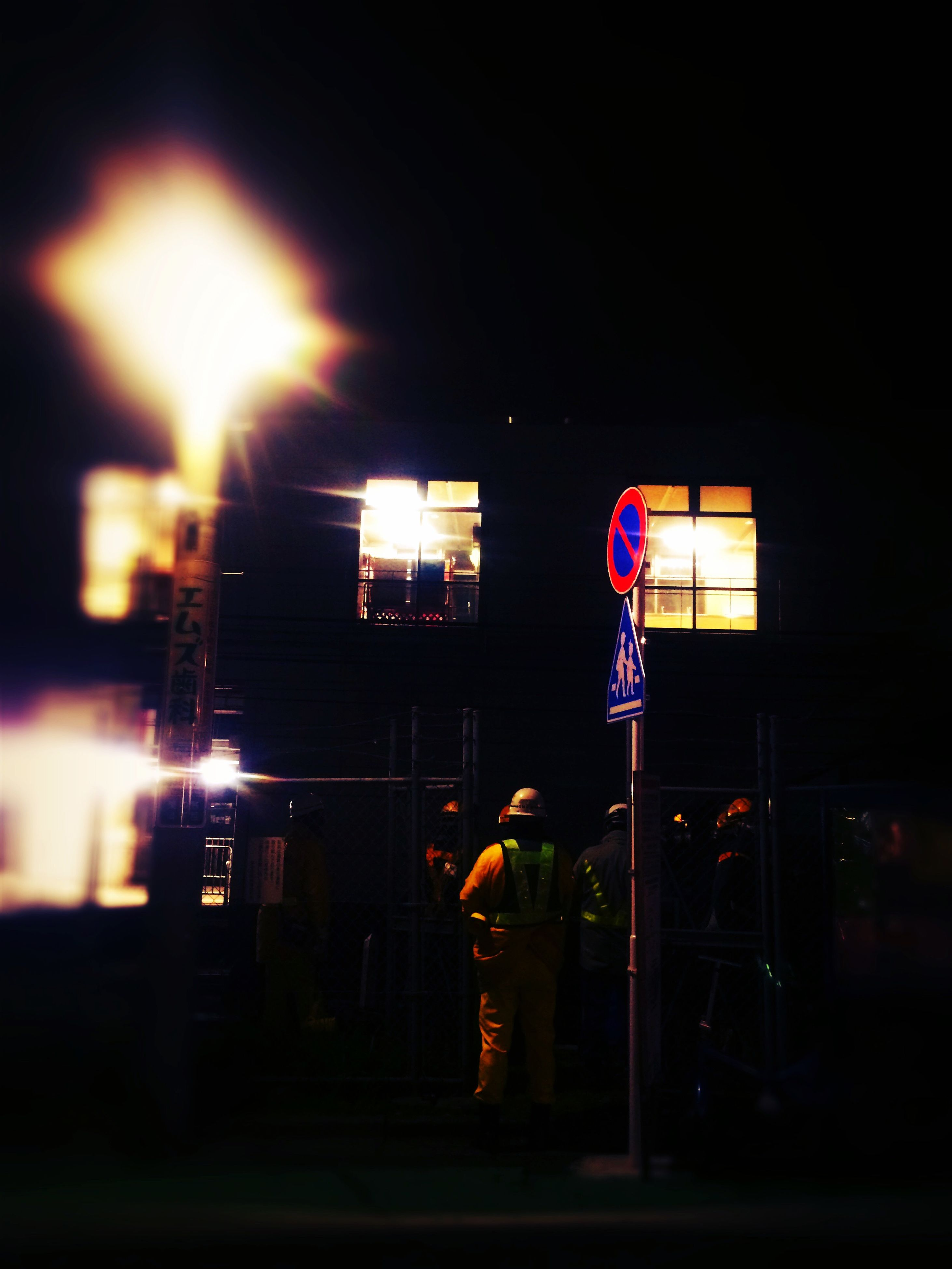 night, illuminated, building exterior, built structure, architecture, lighting equipment, city, street, outdoors, street light, red, human representation, light - natural phenomenon, men, dark, rear view, lantern