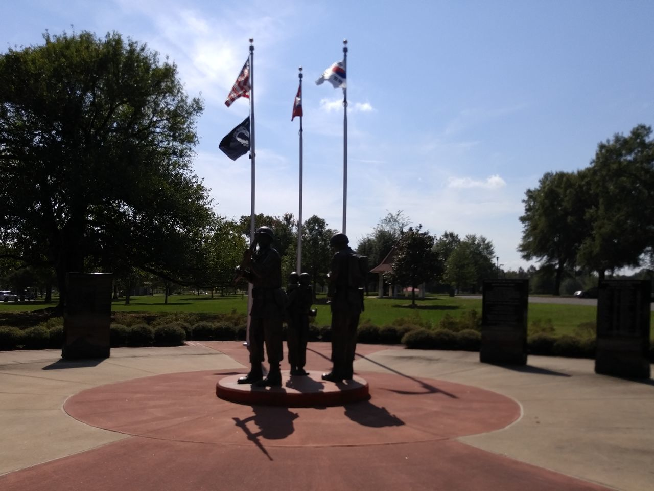 Flag Patriotism Cultures Tree Military Sky Outdoors Day Adults Only No People statues