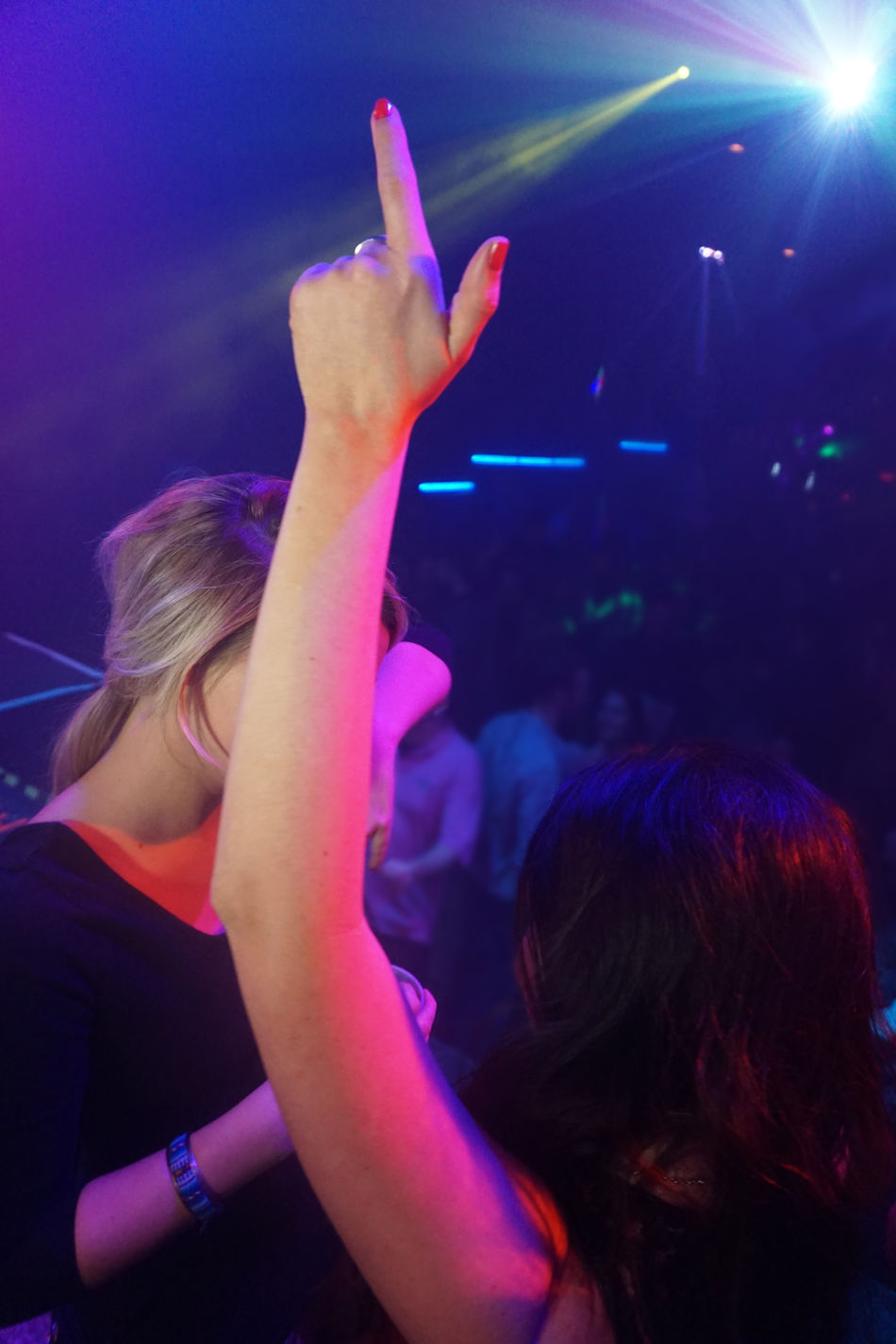 Arts Culture And Entertainment Club Dance Dancing Drink Drinking Enjoyment Illuminated Indoors  Leisure Activity Lifestyles Music Night Nightclub Parties Party Party Girls Performance Person Playing Relaxation Sitting