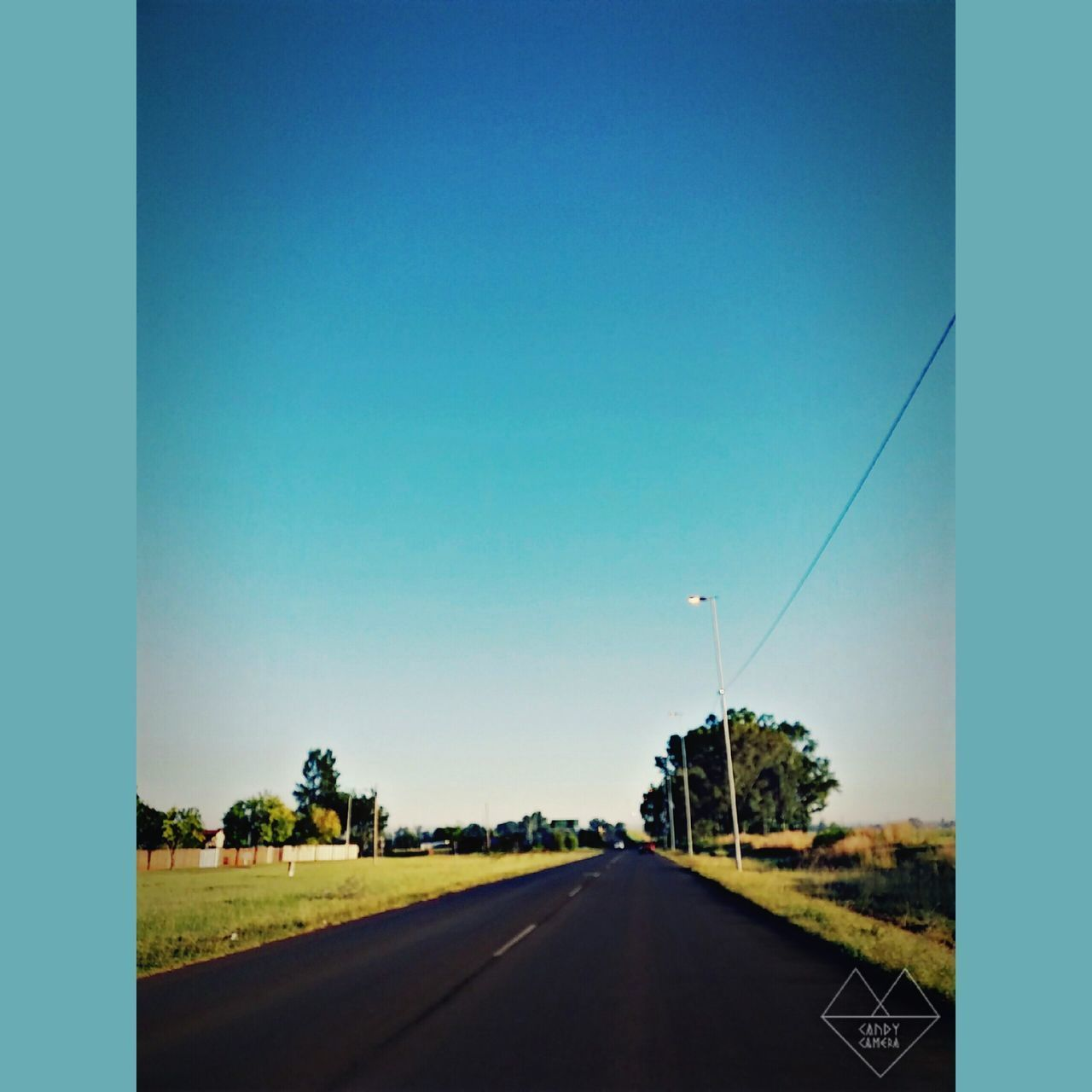road, clear sky, the way forward, transportation, tree, blue, day, no people, nature, outdoors, landscape, grass, sky