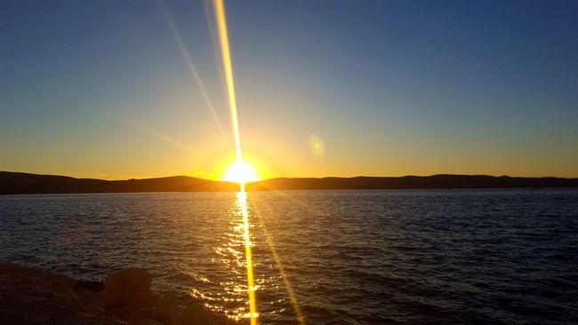 Sunset Reflection Sun Water Sea Refraction Beauty In Nature Horizon Scenics Nature Outdoors Sky No People Day Horizon Over Water Gold Colored Dramatic Sky Sunlight