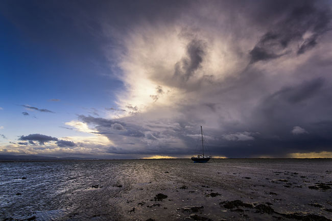 Atmosphere Atmospheric Mood Boat Cloud Cloud - Sky Cloudscape Cloudy Dramatic Sky Majestic Moody Sky Orange Color Outdoors Overcast Scenics Silhouette Sky Storm Cloud Sunset Tranquil Scene Tranquility Wet