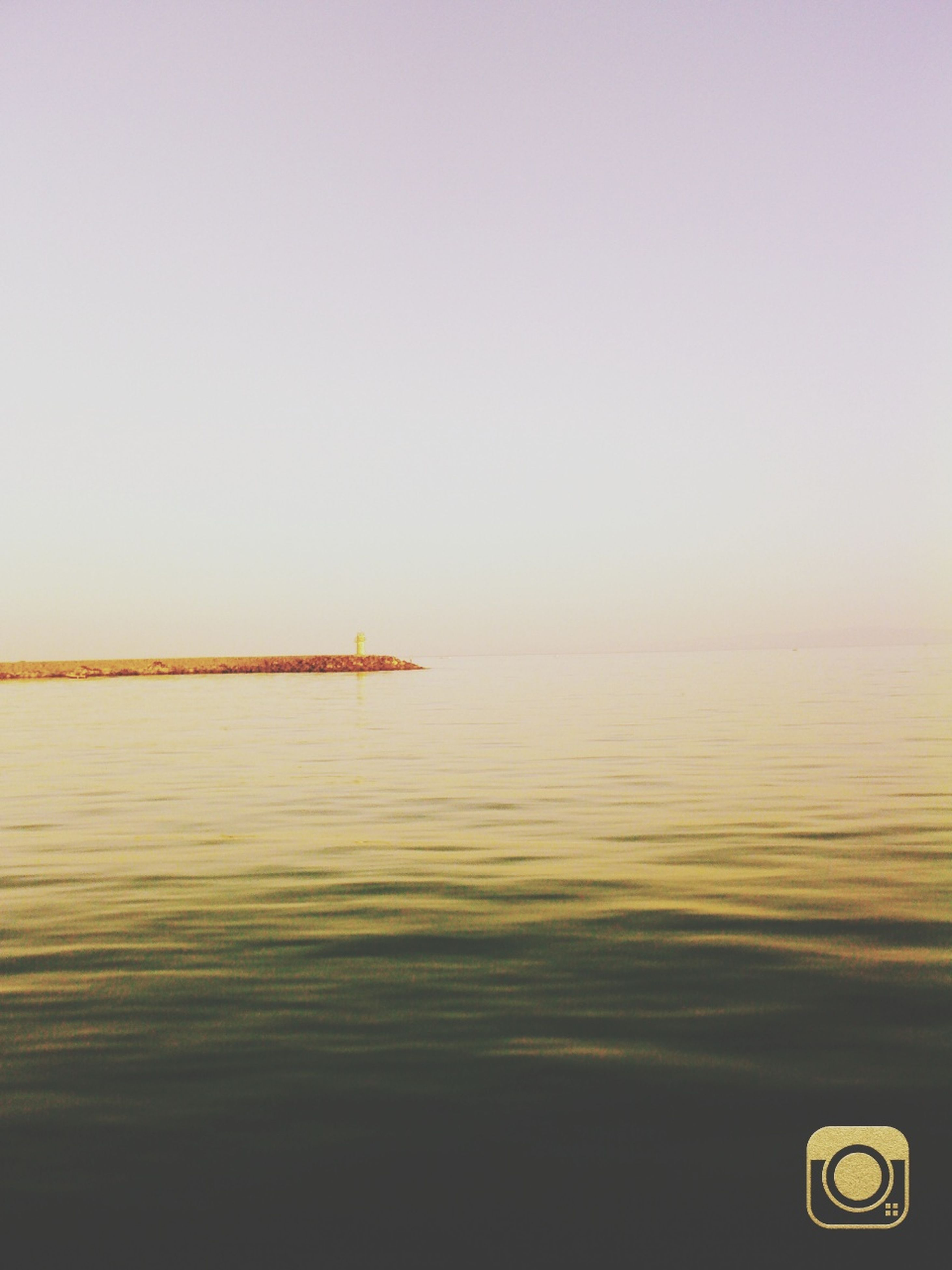 water, sea, copy space, clear sky, tranquil scene, tranquility, waterfront, horizon over water, scenics, transportation, beauty in nature, nautical vessel, mode of transport, nature, boat, rippled, idyllic, reflection, sunset, calm