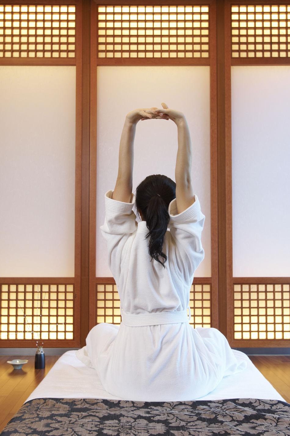 Beautiful stock photos of yoga, Arms Raised, Cross-Legged, Domestic Room, Exercising
