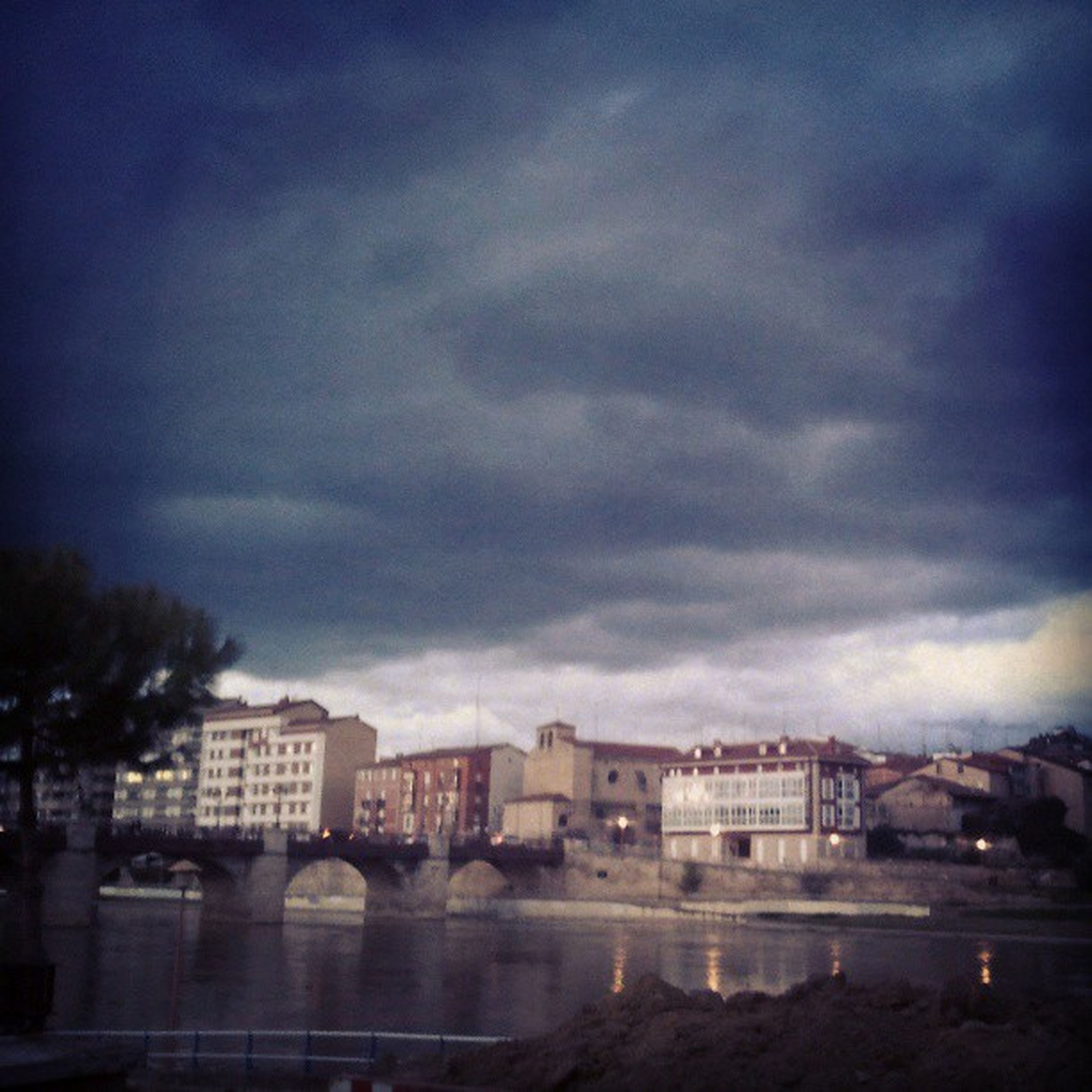 building exterior, architecture, built structure, sky, cloud - sky, cloudy, city, weather, dusk, cloud, water, residential structure, overcast, residential building, building, storm cloud, residential district, cityscape, outdoors, no people