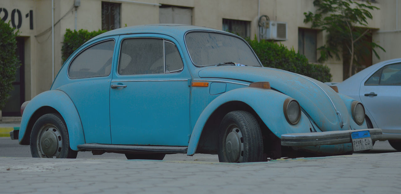 transportation, blue, car, stationary, outdoors, day, no people, land vehicle, close-up