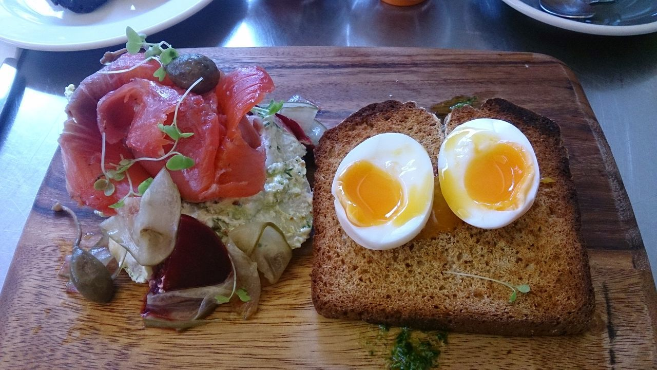 egg, food and drink, food, freshness, healthy eating, breakfast, egg yolk, indoors, ready-to-eat, plate, ham, table, meat, fried egg, serving size, no people, seafood, meal, bread, bacon, close-up, day