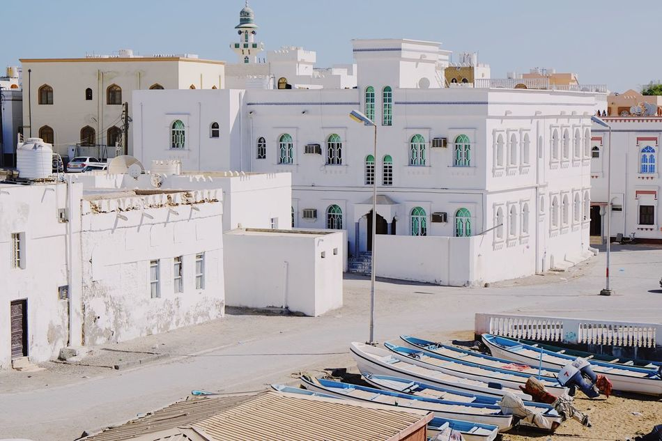 Şūr Oman Architecture Outdoors Sky No People Home House Travel Wanderlust Tourism Tourist Attraction  White Exterior Residential Building City Beach Boat Journey Sightseeing Sand Travel Destinations Travel Photography