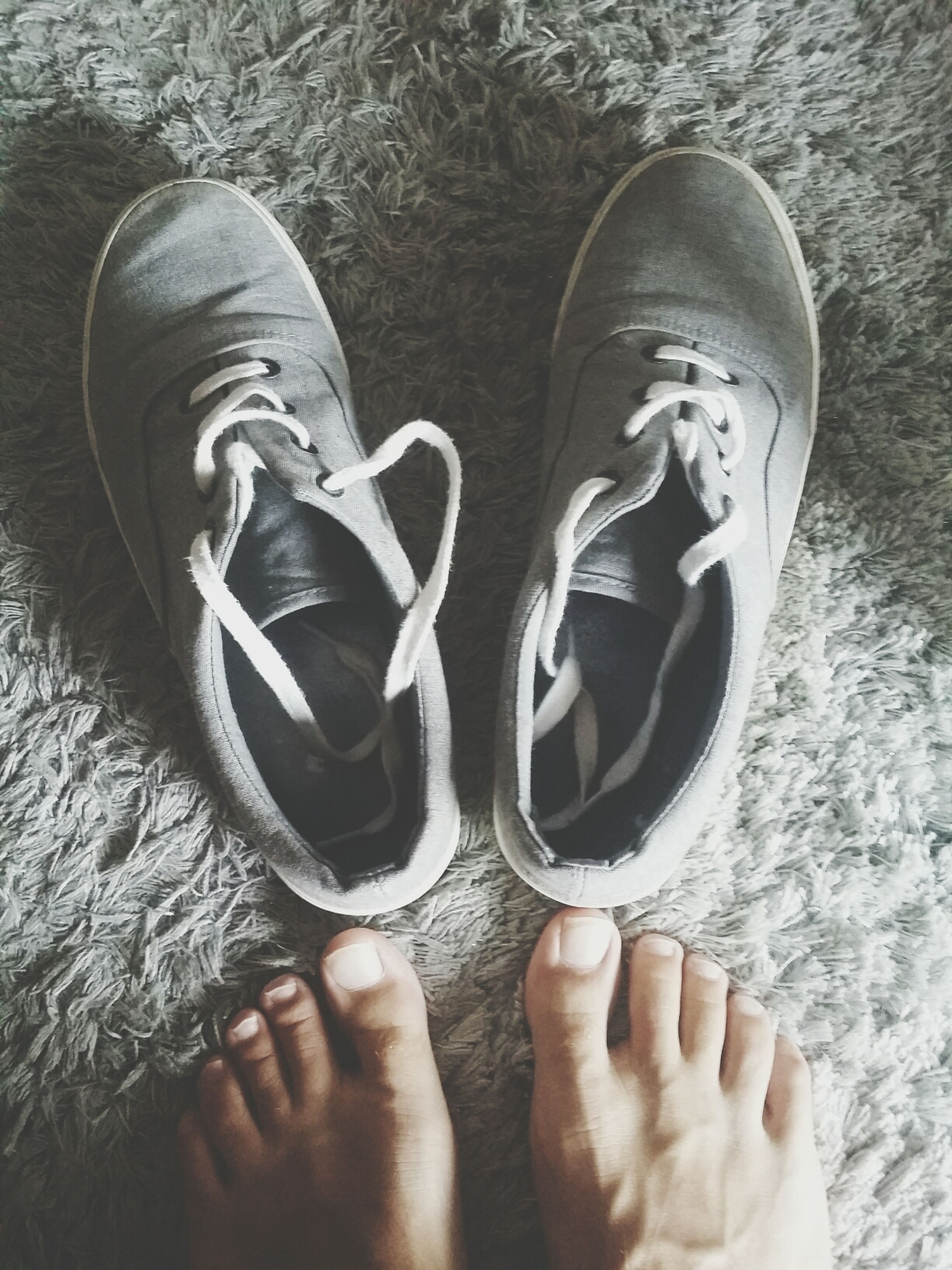 low section, person, shoe, personal perspective, part of, footwear, human foot, lifestyles, high angle view, close-up, standing, leisure activity, unrecognizable person, fashion, directly above, indoors