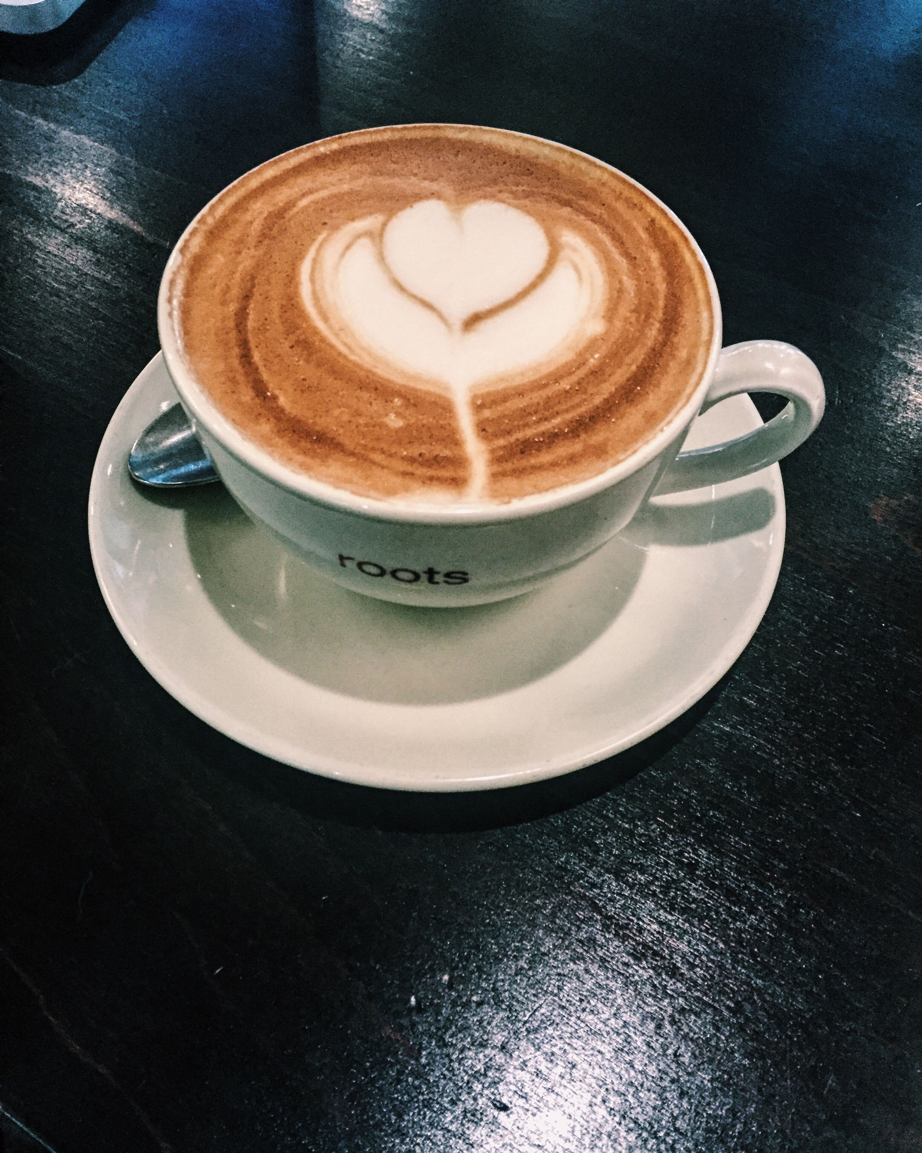 coffee cup, drink, coffee - drink, refreshment, saucer, food and drink, froth art, frothy drink, cappuccino, indoors, coffee, table, freshness, still life, cup, close-up, latte, heart shape, high angle view, spoon