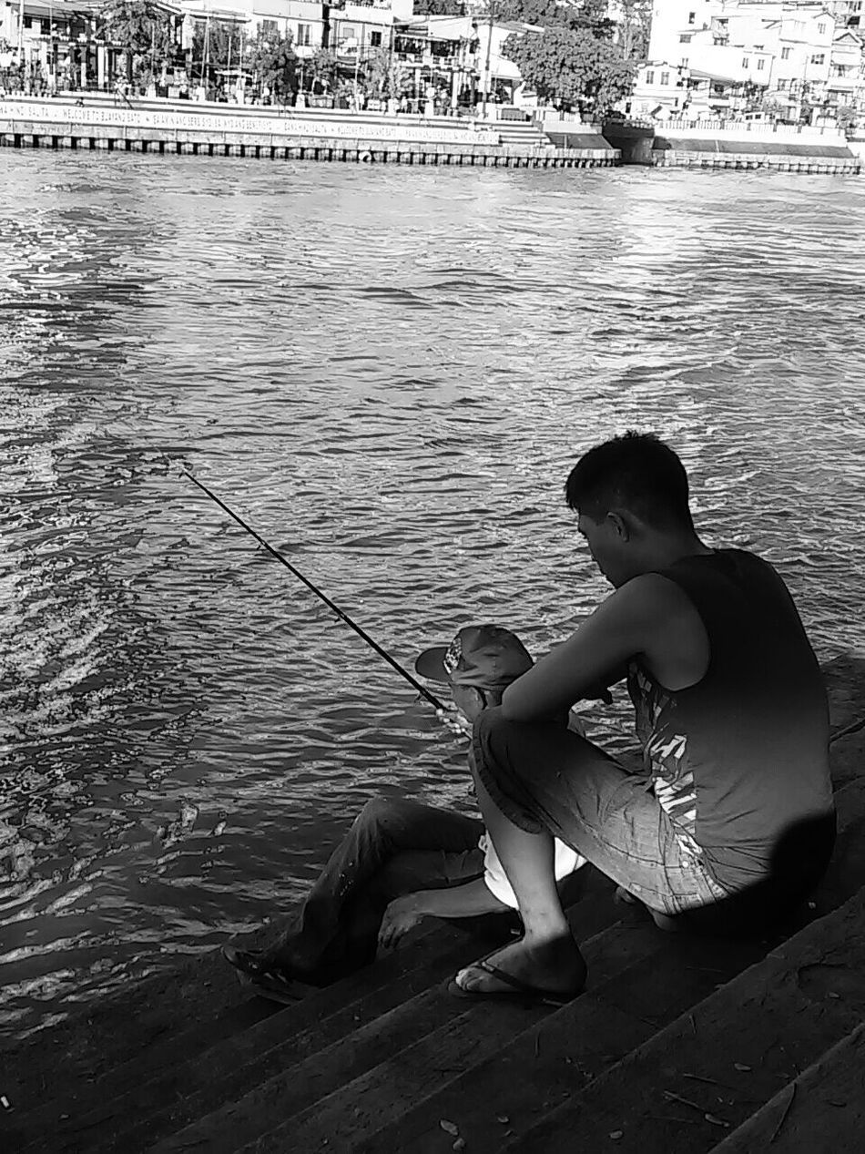 Don't just give fish to a poor man. Rather, teach him how to fish. Eyeem Philippines EyeEm Manila Capture The Moment Bw_collection Blackandwhite The Human Condition Everyday Lives Streetphoto_bw Everyday Philippines My Country In A Photo This Is Philippines Mobilephotography Street Photography Taking Photos Streetphotography Everybodystreet Mobilephotographyphilippines Mobilephotographyph The Street Photographer - 2016 EyeEm Awards Enjoy The New Normal Embrace Urban Life