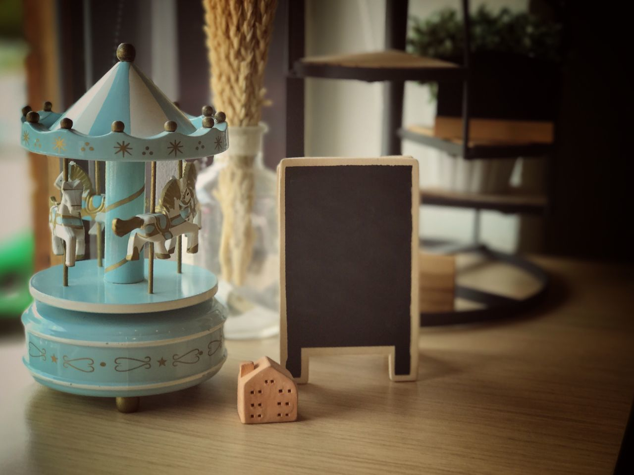 table, indoors, focus on foreground, no people, close-up, home interior, lantern, day