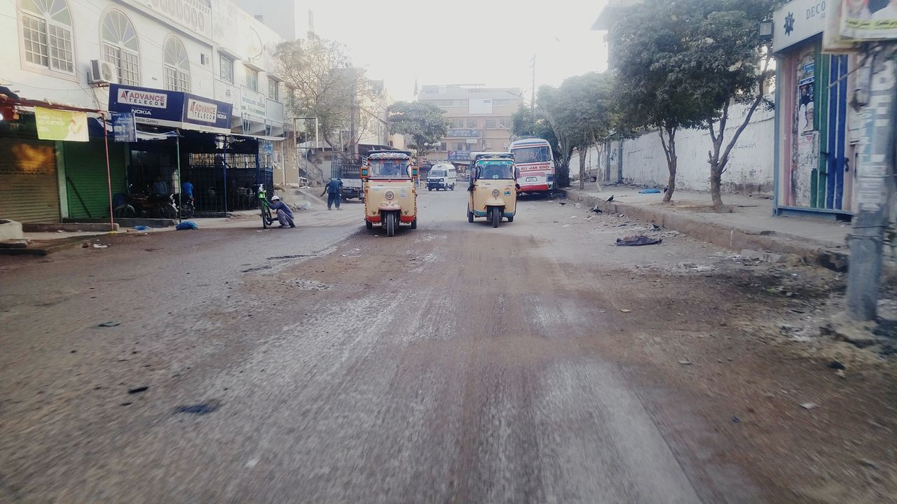 Early morning .. Mode Of Transport Street Wet The Way Forward Outdoors Land Vehicle Architecture City Built Structure Building Exterior Transportation Car Rain Sky Day No People Tree Nature LGG4 Lgg4photography Karachi Travel Popular Photos Sindh Rickshaw
