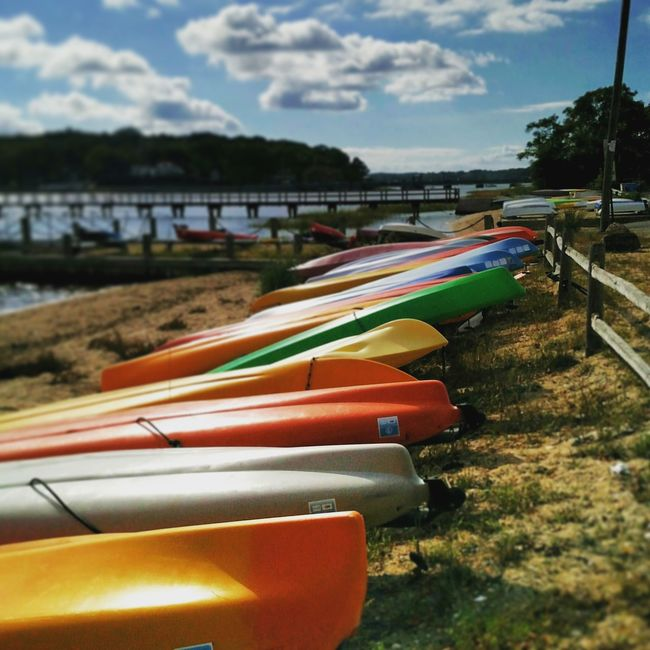 Multi Colored In A Row Colorful Tranquil Scene Sea The Way Forward Vibrant Color Tranquility Canoes Canoekayak Beachphotography Beachside