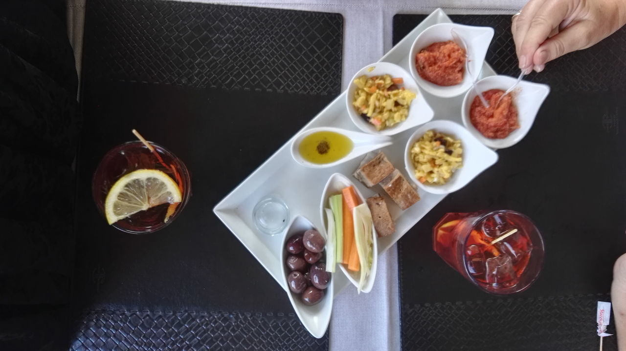 Aperitivo  Cocktails Cropped Day Drinks Hand Leisure Activity Lifestyles Part Of Personal Perspective Ready-to-eat Serving Size Snacks Unrecognizable People Unrecognizable Person