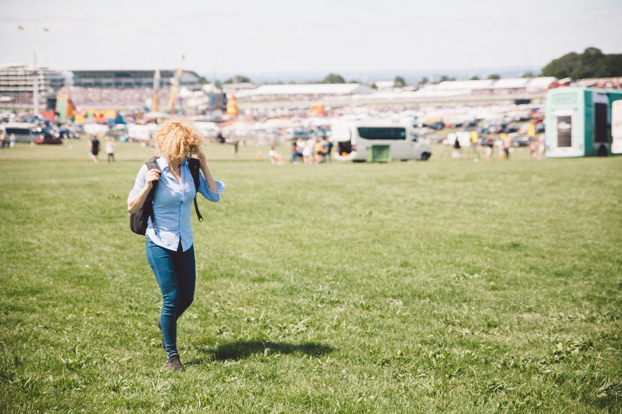 Adult Camera - Photographic Equipment Casual Clothing Day Epsom Downs Racecourse Field Grass Mobile Phone Nature One Person Outdoors People Photographing Photography Themes Real People Sky Technology Wireless Technology Women Young Adult Young Women