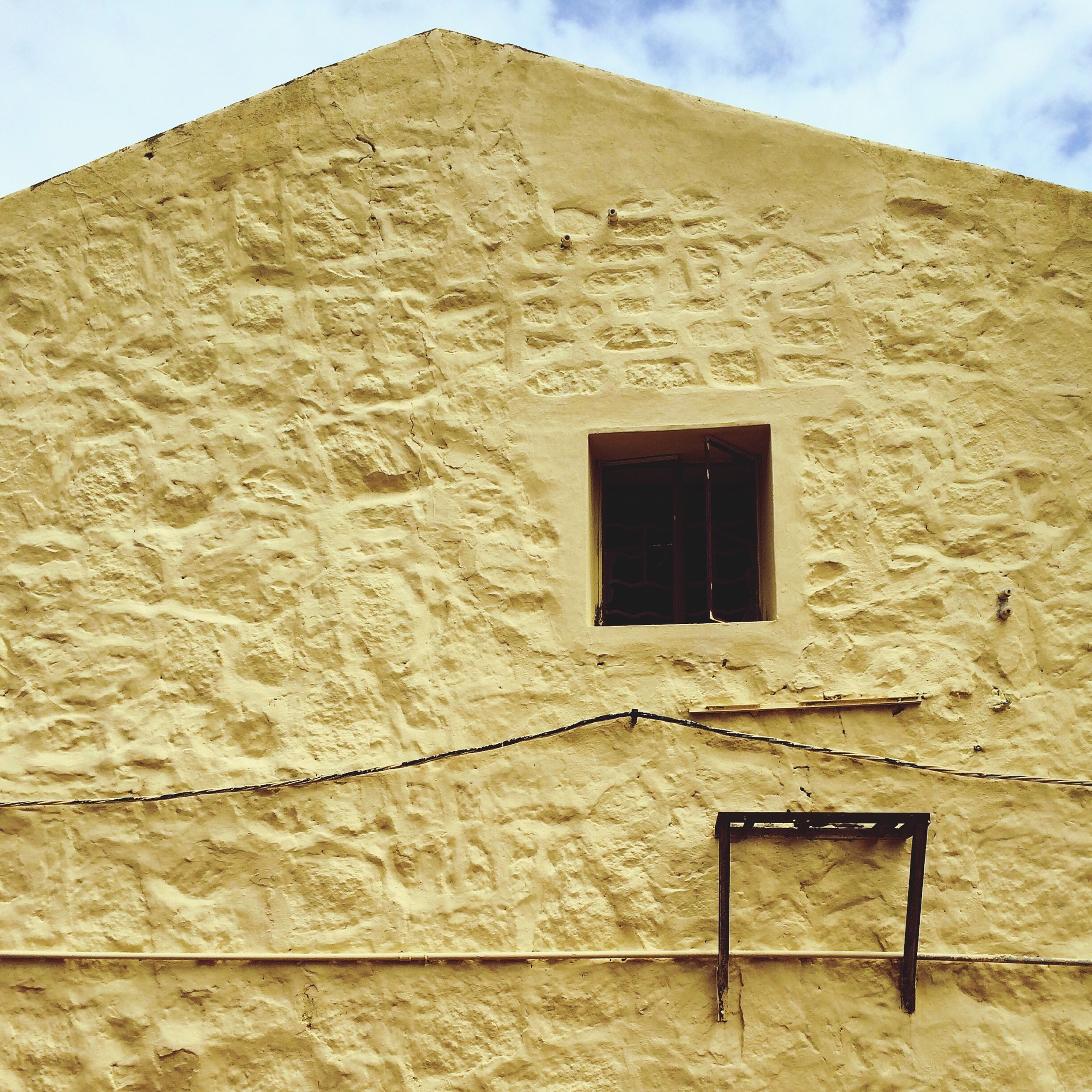 architecture, building exterior, built structure, window, sky, low angle view, house, wall - building feature, brick wall, old, day, stone wall, wall, no people, sunlight, outdoors, history, wood - material, facade, door