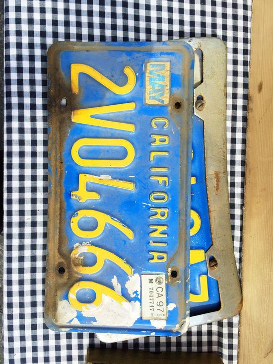 Blue Blue Sky California Close-up Communication Day Green Color High Angle View Indoors  Large Group Of Objects License Plate License Plates Metal Multi Colored No People Number Plastic Still Life Table Text Variation Western Script Wood - Material Yellow Yellow Flower