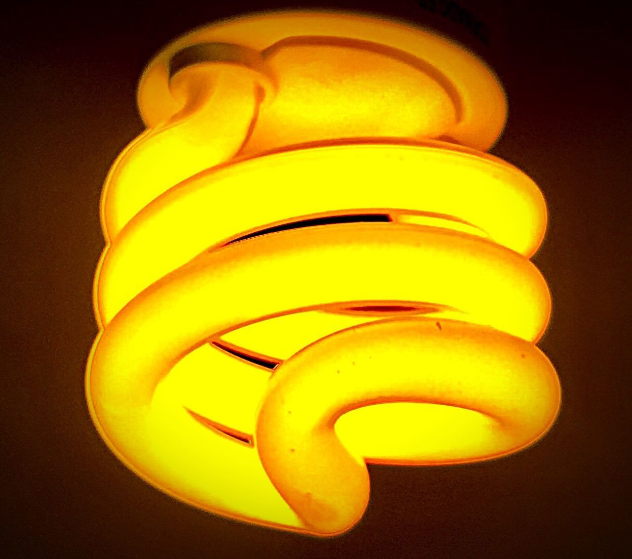 Energy Efficient Lightbulb Energy Efficient Spiral Lighting Equipment Light Bulb Yellow Illuminated Electricity  No People Close-up Low Angle View Indoors  Resist EyeEm Diversity The Secret Spaces Long Goodbye TCPM EyeEmNewHere