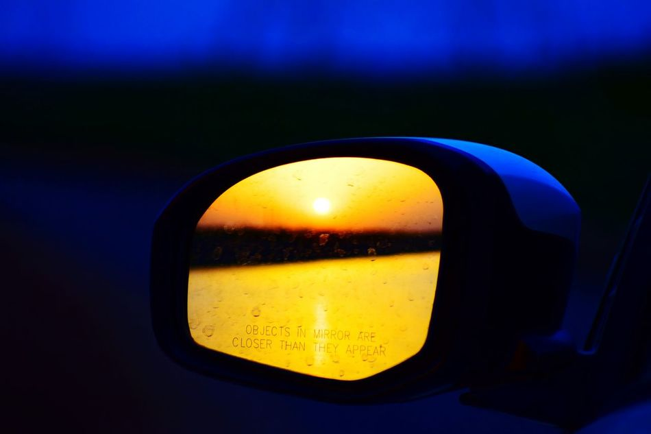 Watching The Sunset Close-up Selective Focus Contrasts Sun Sunset Nature Sky Car Outdoors Transportation Sunset Silhouettes Travel Destinations No People Mirror Riverside River View River Collection Riverside Photography Riverwalk