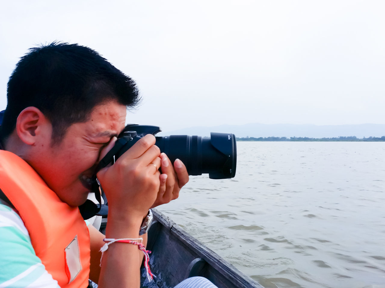 Travel photography. Photography Themes Water Holding Men Photographing Camera - Photographic Equipment Leisure Activity Outdoors People Nature Day Photography One Person SLR Camera Vacation Travel Thailandtravel Relax Weather Man Beauty In Nature Asian  Thailand Environment Portrait