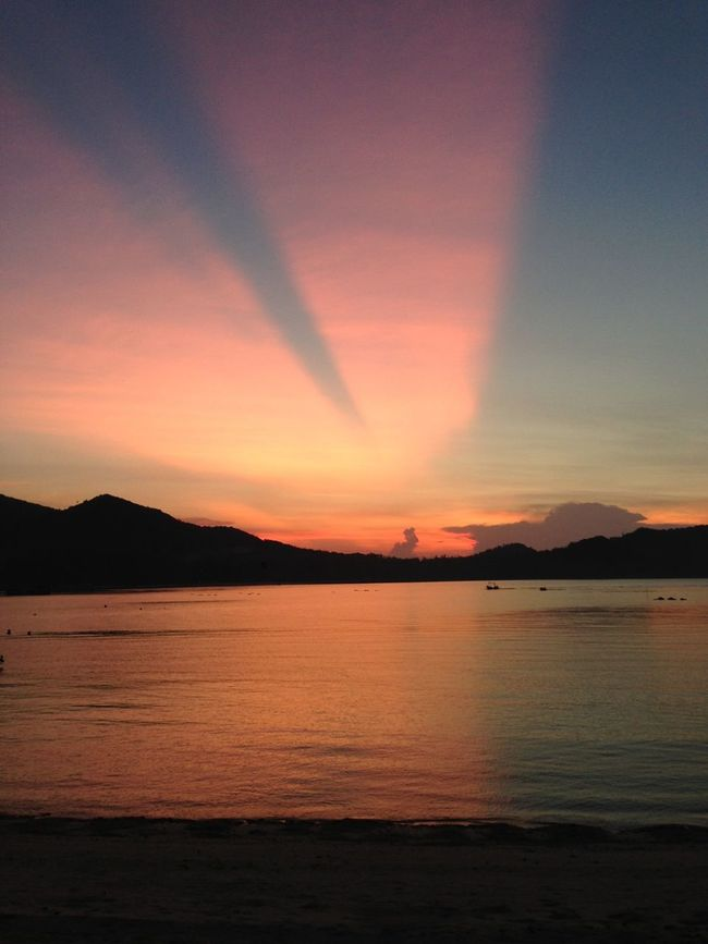 Paradise. Unbelievable Sunset Stunning Sunset Paradise Beach Fanta Beach Orange Pink Skies Thailand Sunset Dreamy Sun Rays Chaloklum No Edit/no Filter Living Free Seascape At Peace Freedom Sunset Happiness Calm Water Mountain Silhouette Beams Of Light Pastel Power Tranquil Spotted In Thailand