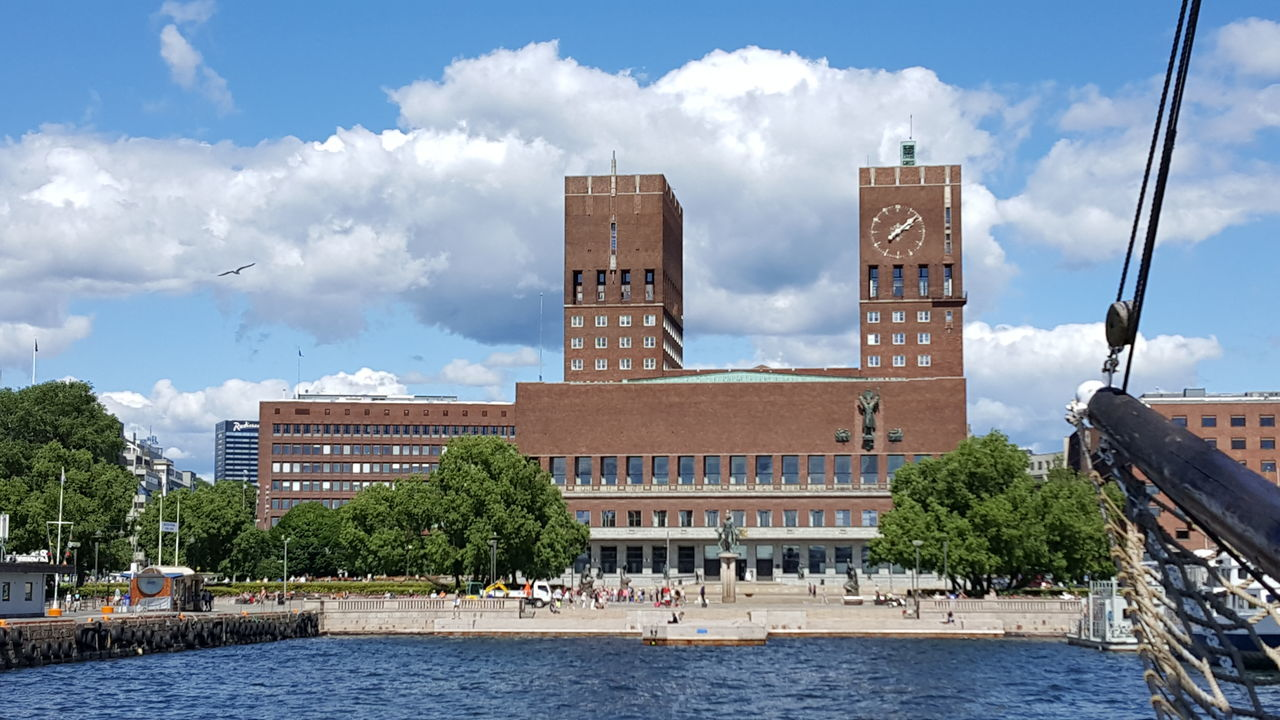 "Oslo City Hall (Norwegian: Oslo rådhus) houses the city council, city administration, and art studios and galleries. The construction started in 1931, but was paused by the outbreak of World War II, before the official inauguration in 1950. Its characteristic architecture, artworks and the Nobel Peace Prize ceremony, held on 10 December, makes it one of Oslo's most famous buildings. It was designed by Arnstein Arneberg and Magnus Poulsson. The roof of the eastern tower has a 49-bell carillon which plays every hour. It is situated in Pipervika in central downtown Oslo. The area was completely renovated and rebuilt to make room for the new city hall, back in the late 1920s. In June 2005 it was named Oslo's ""Structure of the Century"", with 30.4% of the votes. Architectural Column Architectural Detail Architectural Feature Architecture Architecture Details Architecture Photography Architecture_bw Architecture_collection Architecturelovers Architecturephotography Architectureporn City Hall Eye4photography  EyeEm EyeEm Best Shots EyeEm Gallery EyeEmBestPics From My Point Of View Getting Inspired Hidden Gems  Nobel Peace Prize Politics Rådhus Rådhuset The Purist (no Edit, No Filter)"
