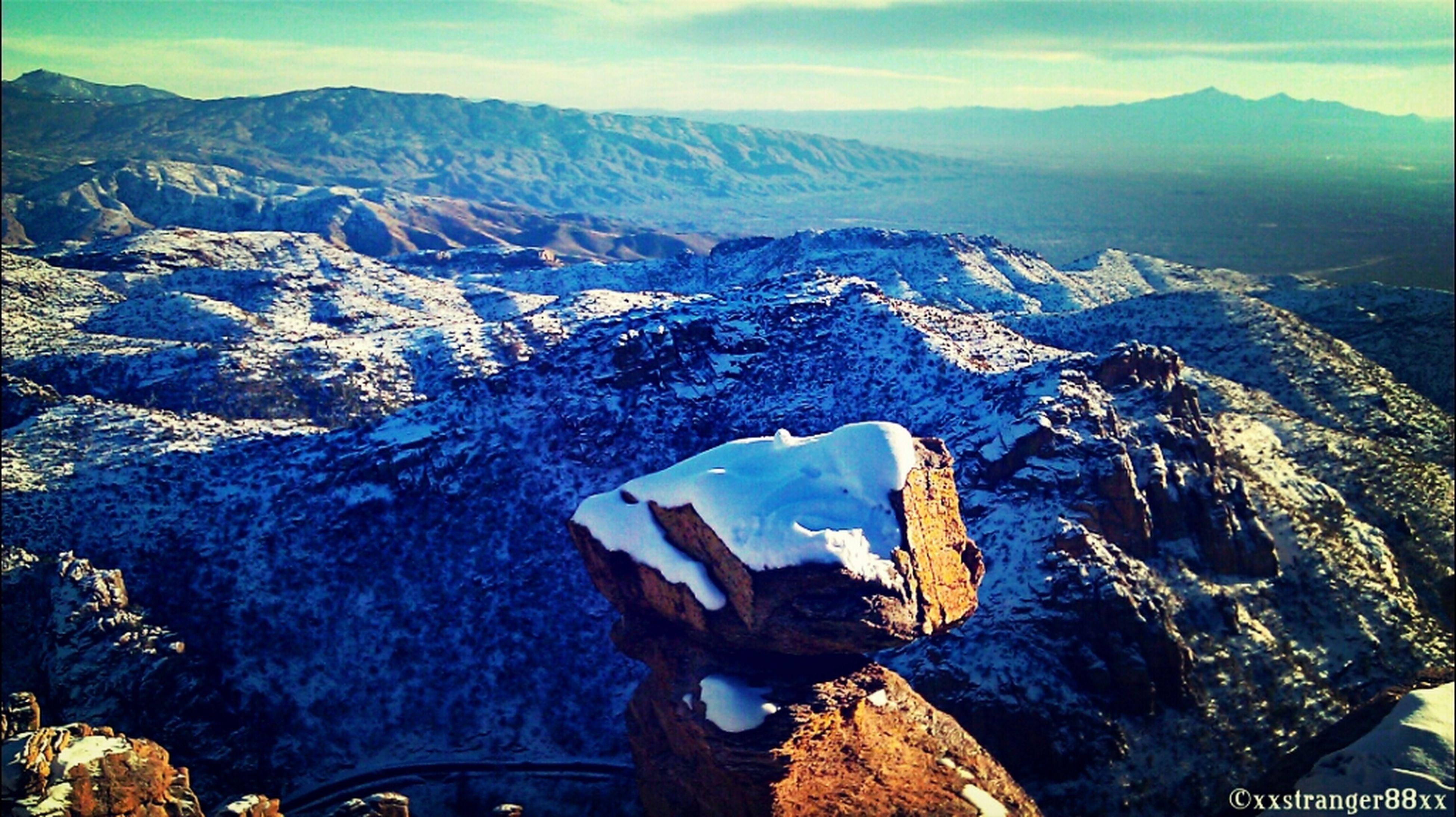 mountain, mountain range, snow, winter, scenics, cold temperature, tranquil scene, beauty in nature, tranquility, snowcapped mountain, landscape, nature, sky, water, non-urban scene, season, lake, high angle view, idyllic, mountain peak