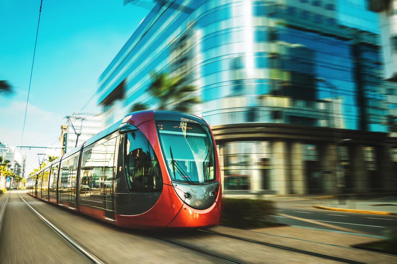 Business Casablanca Cityscape Morocco Moving Tram Transport Architecture Blur Blurred Motion Building Built Structure Day Mode Of Transport Motion No People Outdoors Public Transportation Road Sky Speed Streetcar Technology Transportation Vehicle